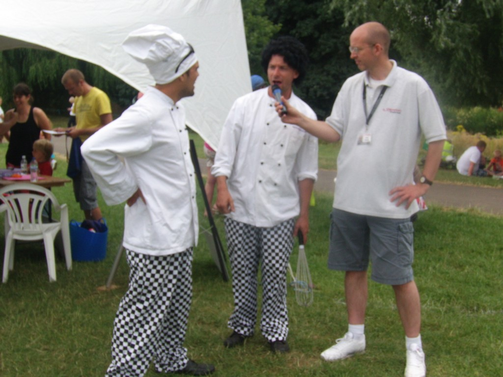 Presenter Chris Daniels gets some cooking tips from the Zooted Mad Chefs